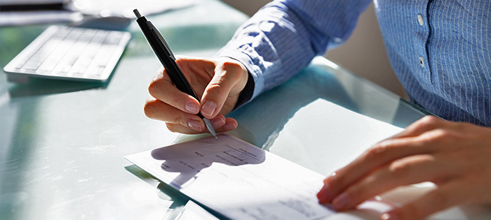 Employer Signing Payroll Check